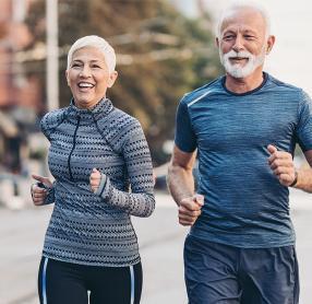 Senior man and woman jogging