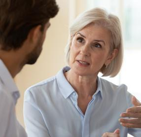 Woman speaking with audiologist