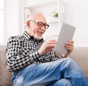 Elderly man using tablet